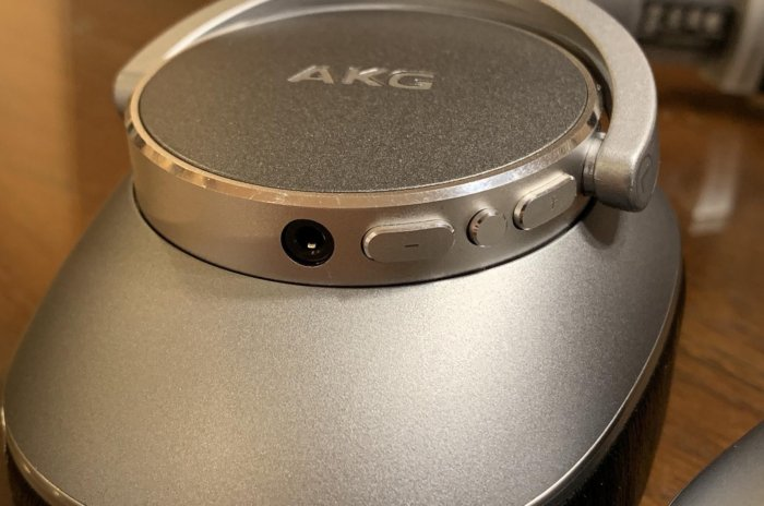 Detail view of the volume controls on the left ear cup.