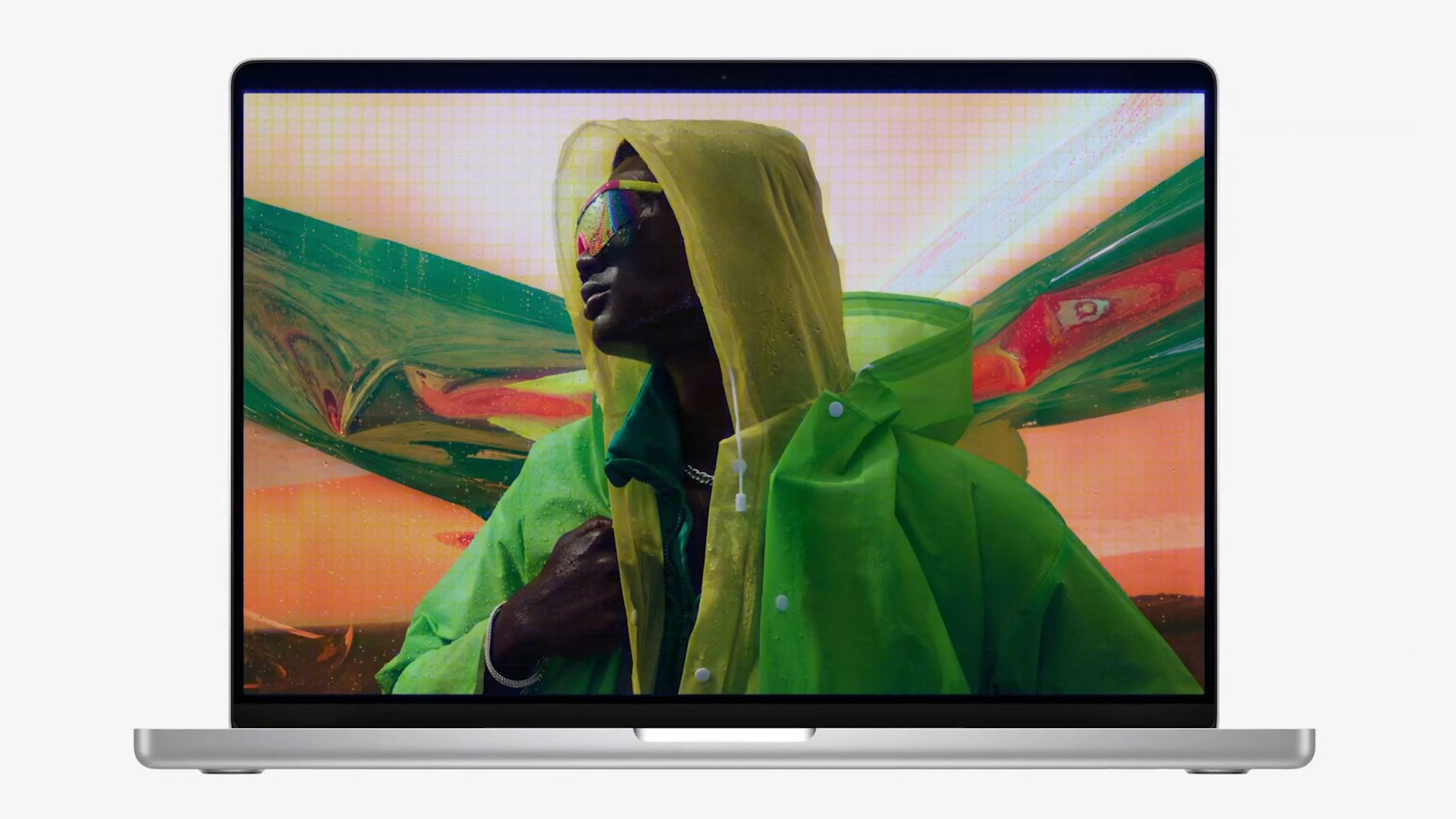 The MacBook Pro 14-inch (2021) featuring a model wearing vivid, colorful clothing